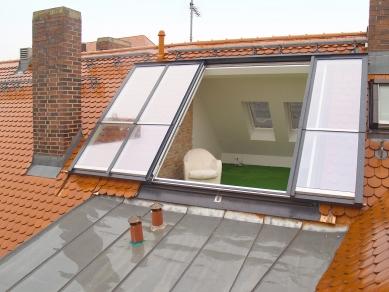 Posuvná střešní okna v centru Vídně - Odsuvné ateliérové prosklení Solara PERSPEKTIV umožňující výstup  na budoucí terasu, Mnichov - foto: archiv firmy Solara s.r.o.